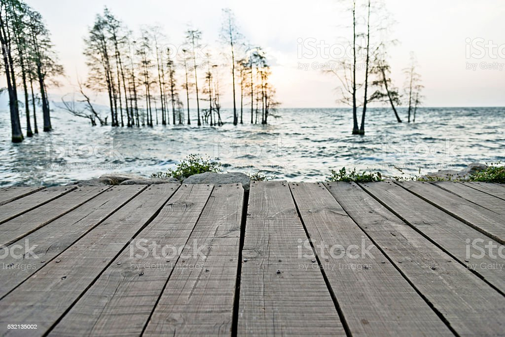 Wooden pier on the lake stock photo