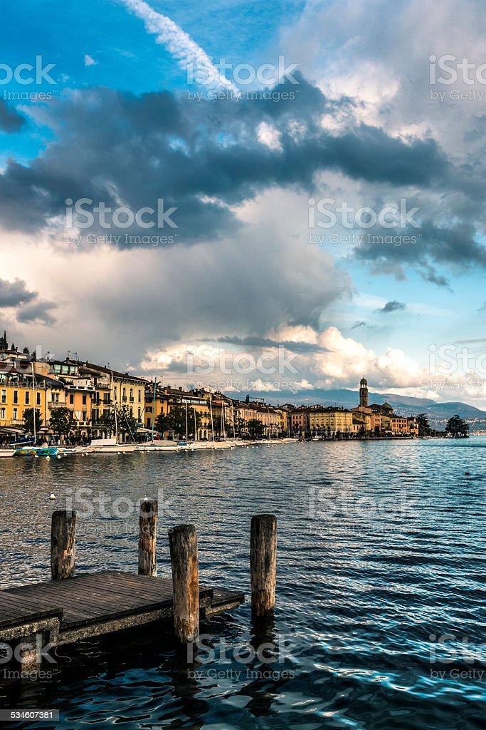 wooden pier on the lakefront of Garda stock photo
