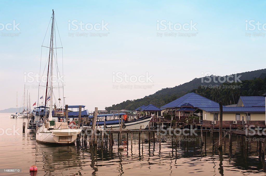 Wooden pier on tropical island stock photo