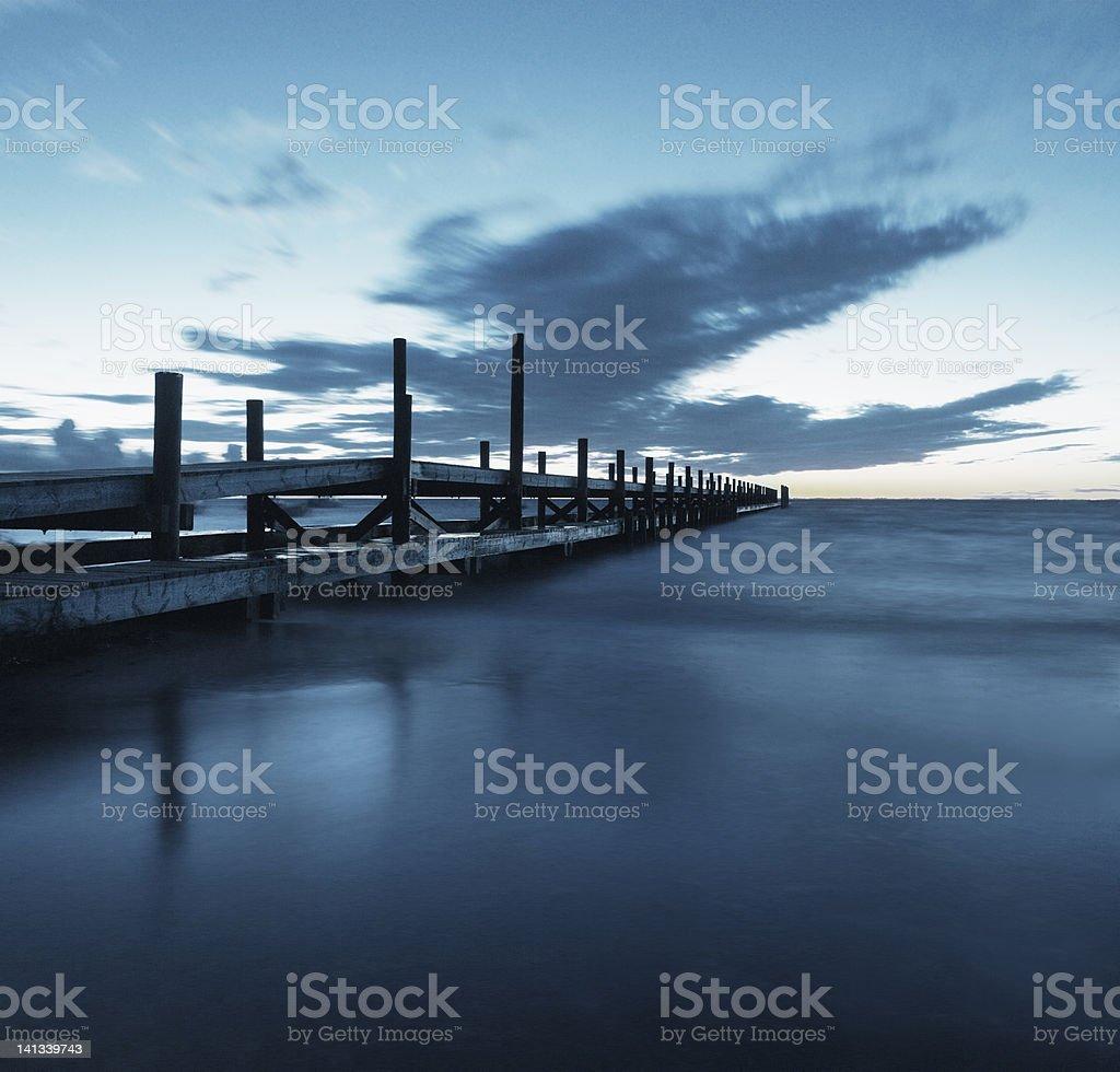 Wooden pier over ocean stock photo