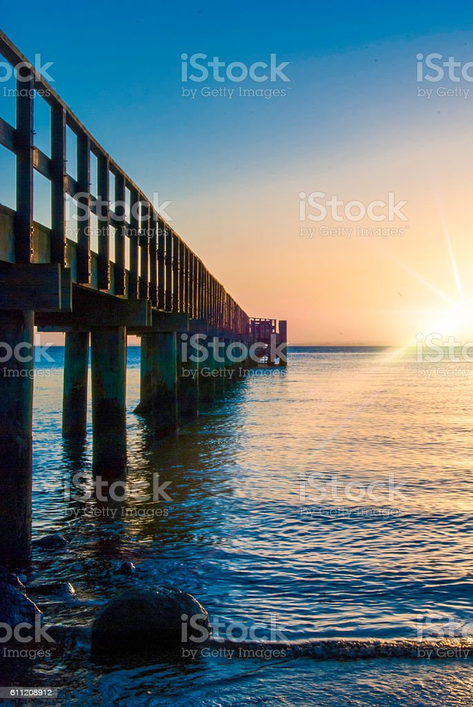 Wooden pier with flare stock photo