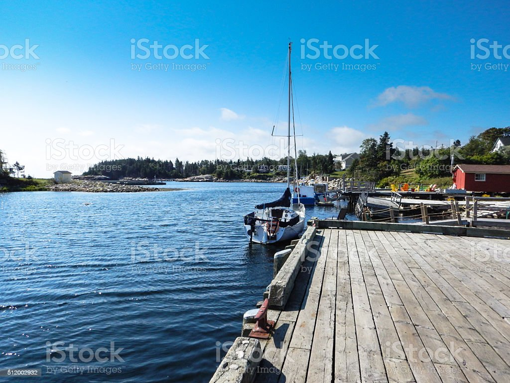 wooden pier with the fishing boat stock photo