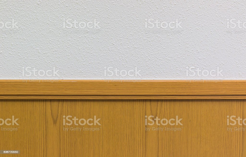 Wooden plank against white concrete wall. banner background. stock photo