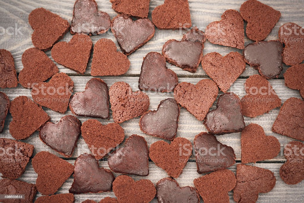 Wooden plank full of chocolate cookies stock photo