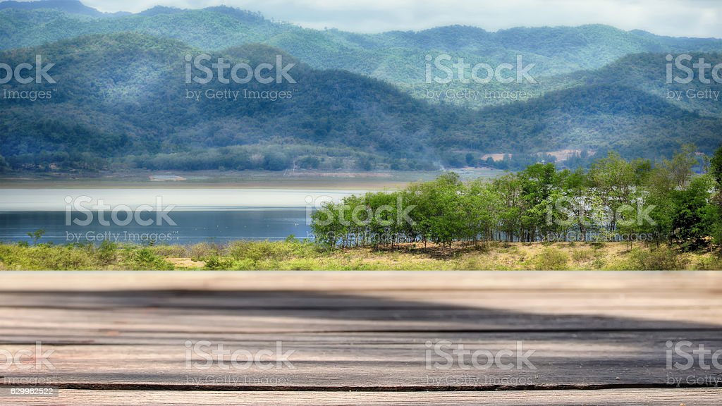 Wooden plank with mountain landscape view background stock photo