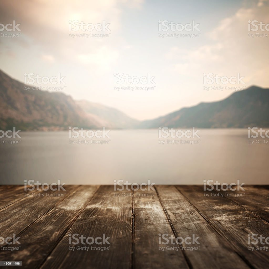 Wooden planks and defocused summer landscape on background stock photo