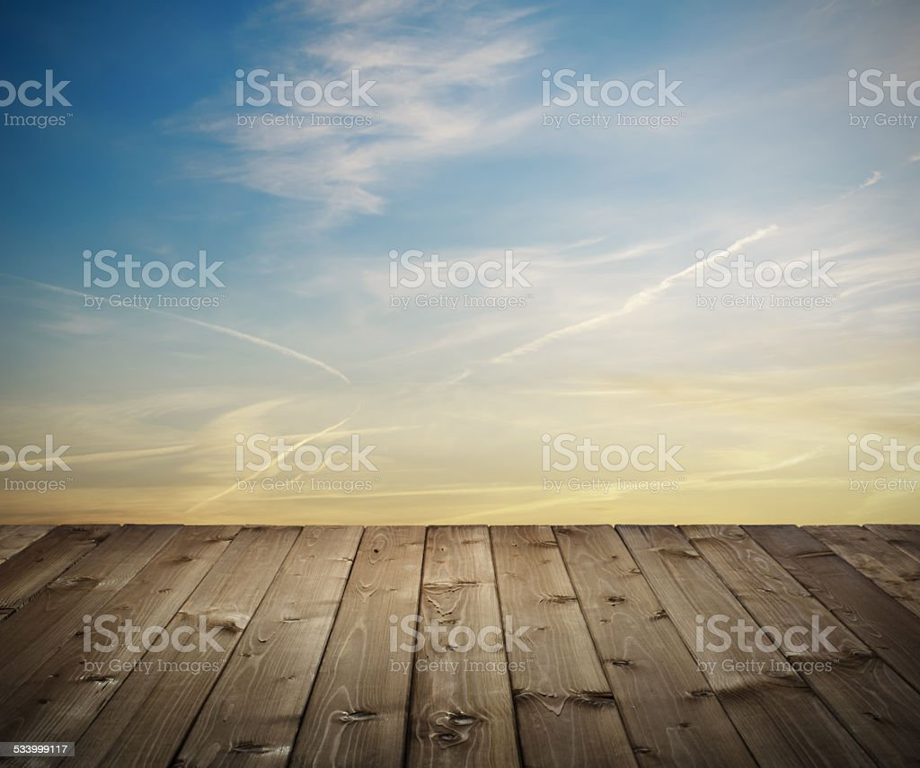 wooden planks at sunset stock photo