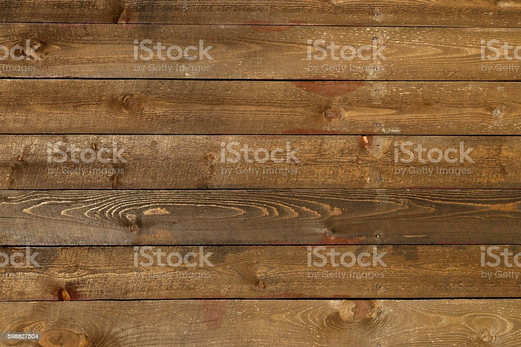Wooden planks background with knots and nail holes stock photo