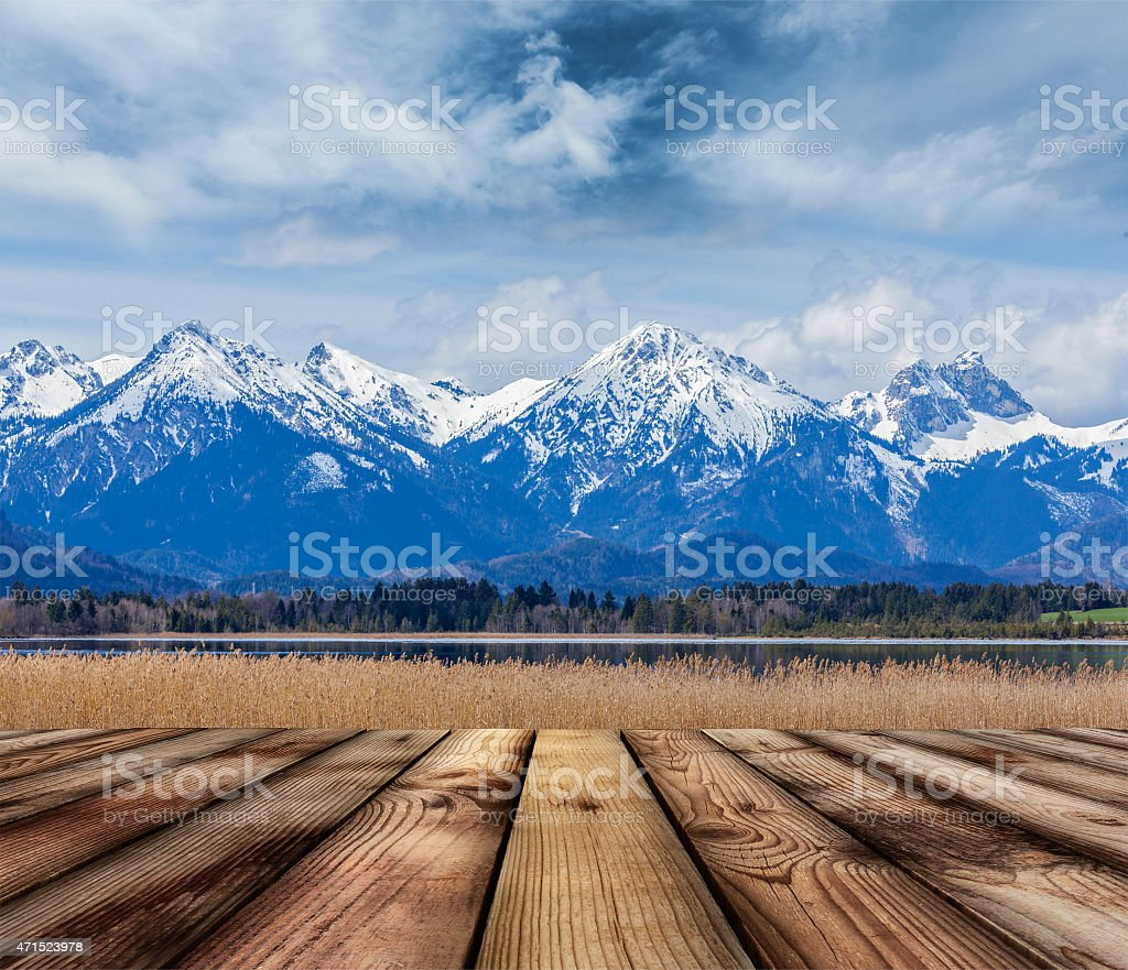 Wooden planks floor with Bavarian Alps landscape stock photo