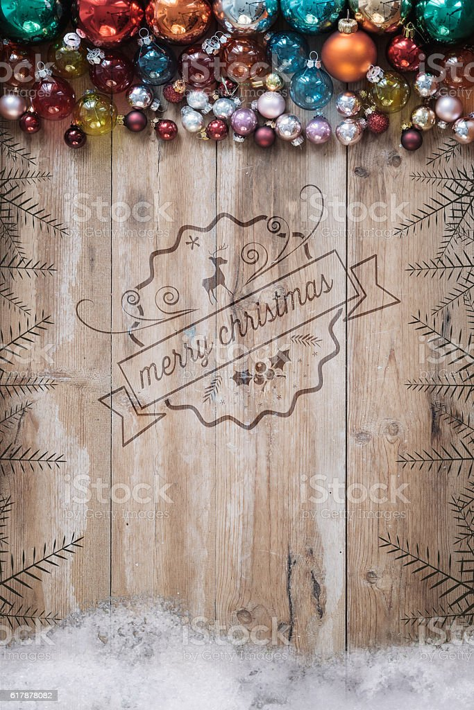wooden planks with christmas label embossing and retro balls stock photo