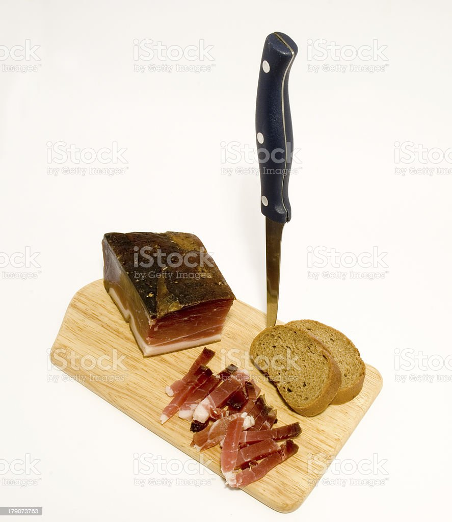 Wooden plate of speck royalty-free stock photo