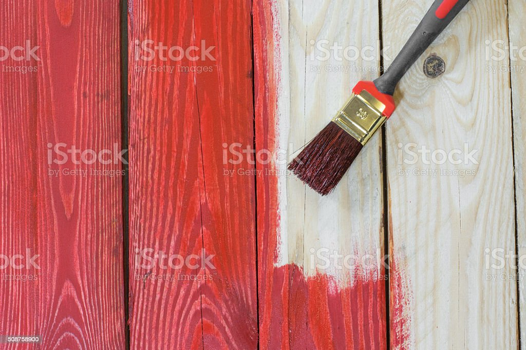 Wooden Plate with a Brush while Painting stock photo