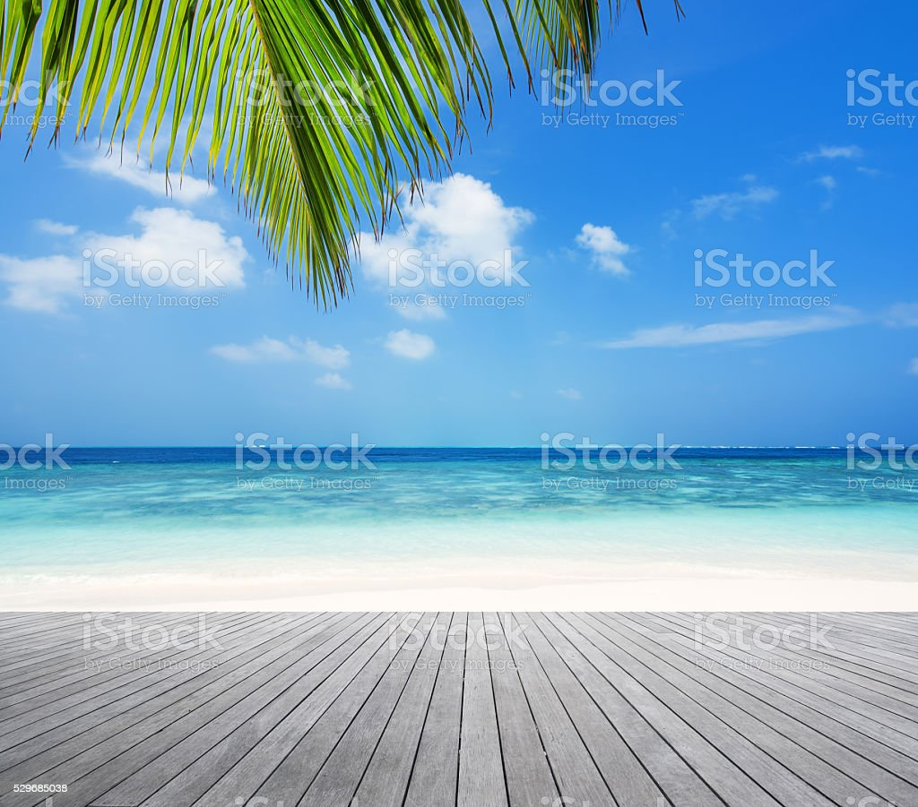 Wooden platform and tropical beach background stock photo