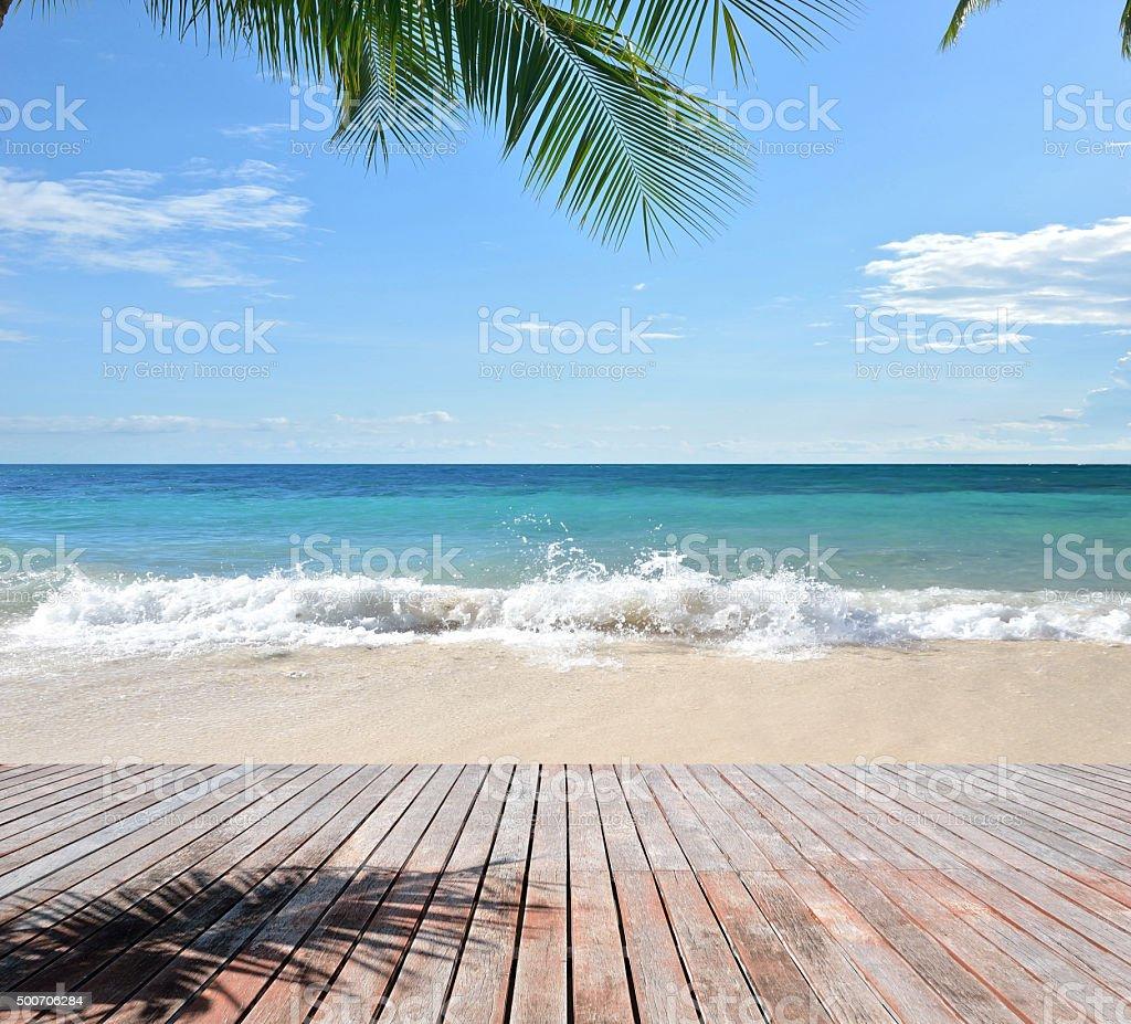 Wooden platform beside tropical beach stock photo