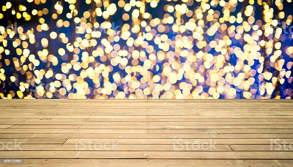 Wooden platform with defocused lights background stock photo