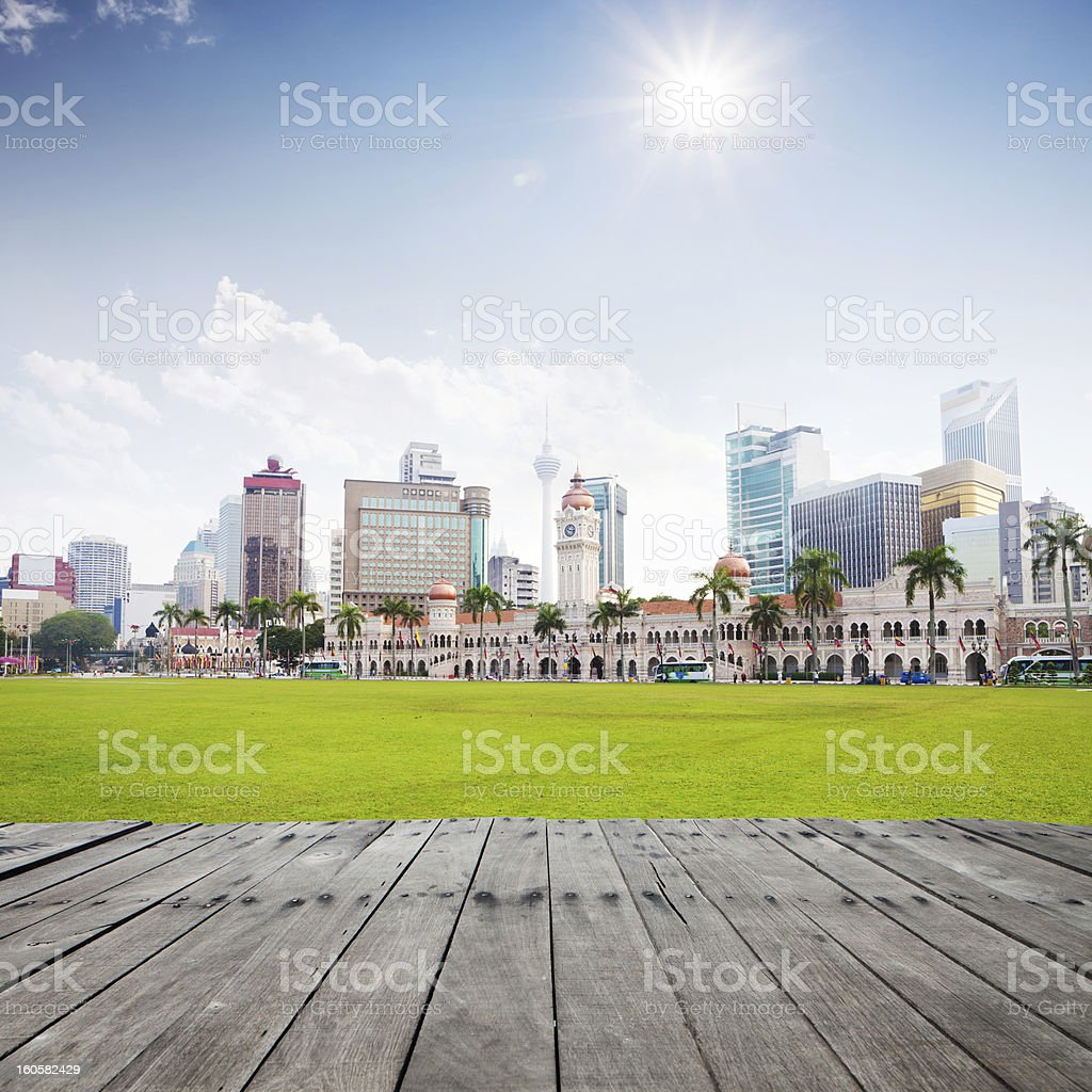 wooden platform with modern city royalty-free stock photo