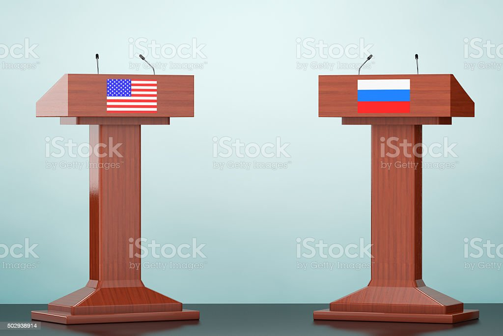 Wooden Podium Tribune Rostrum Stands with USA and Russian flags stock photo