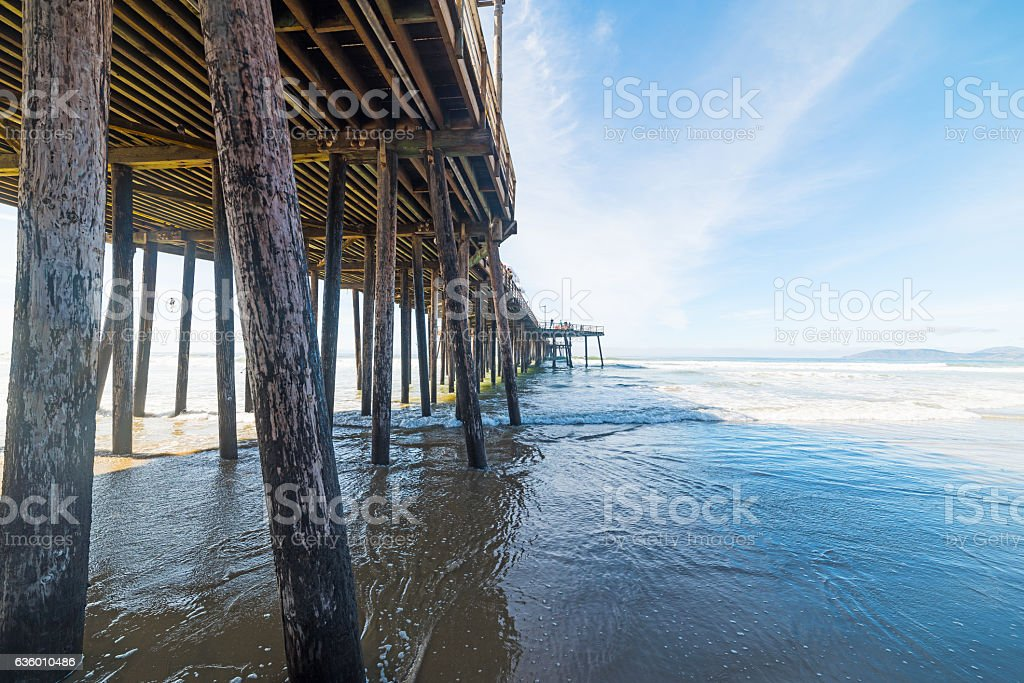 wooden poles in Pismo Beach pier stock photo