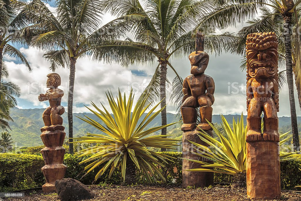 Wooden Polynesian tiki statues stock photo