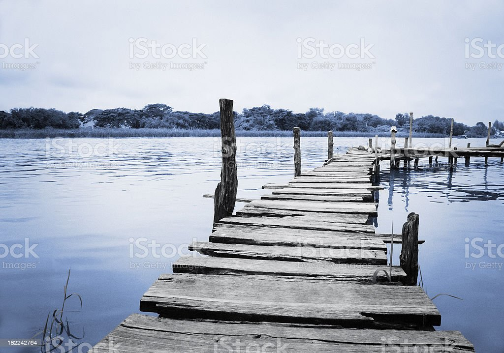 Wooden pontoon bridge out over river in Thailand stock photo