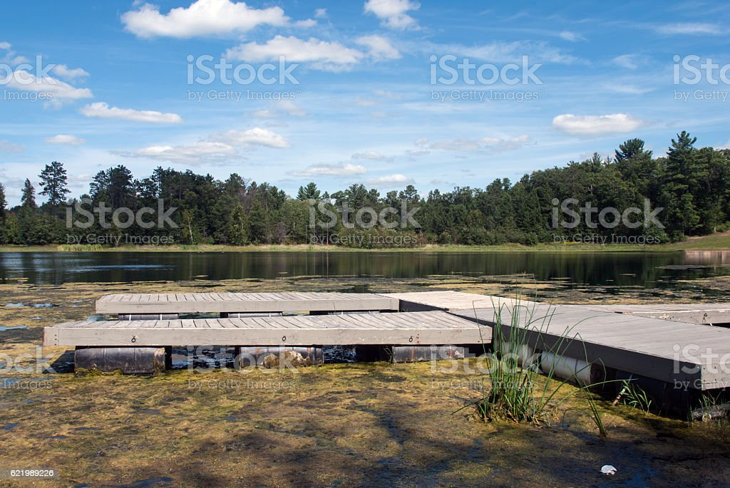 Wooden pontoon pier on a forest lake, Marinette County, Wiscon stock photo