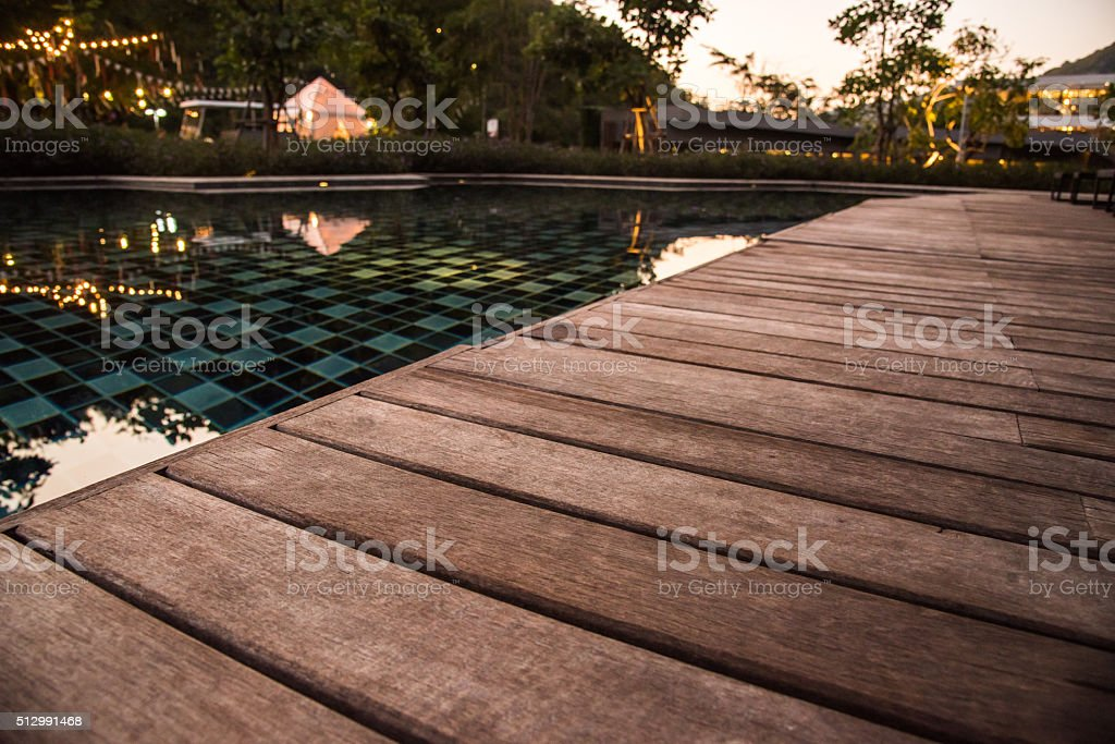 wooden pool terrace in evening time stock photo