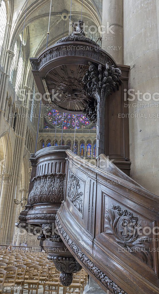 Wooden pulpit in Reims Notre-Dame Cathedral, France royalty-free stock photo