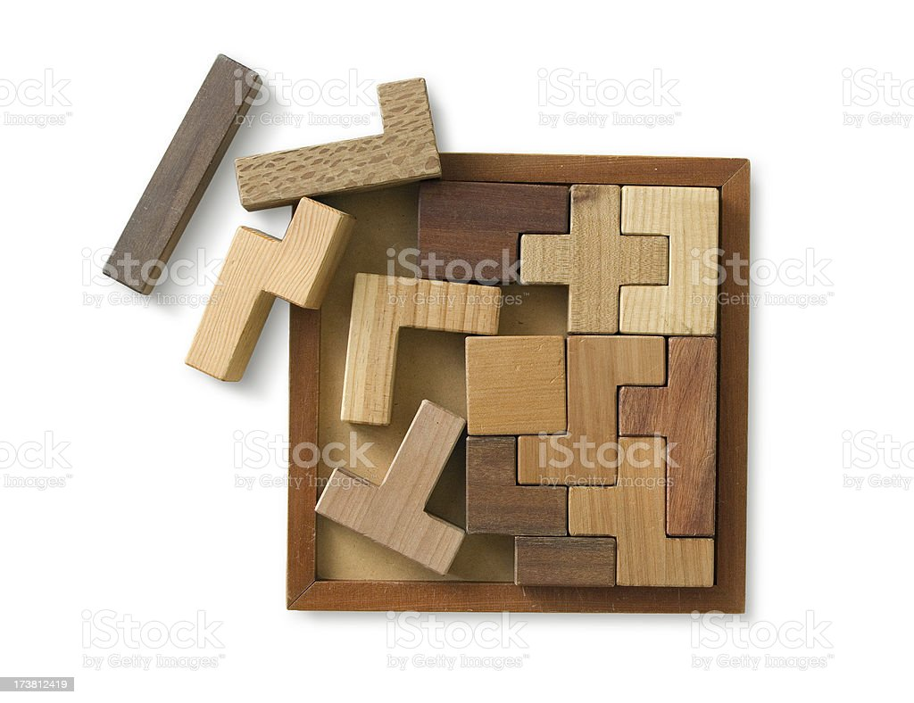 Wooden Puzzle isolated on white with clipping path stock photo