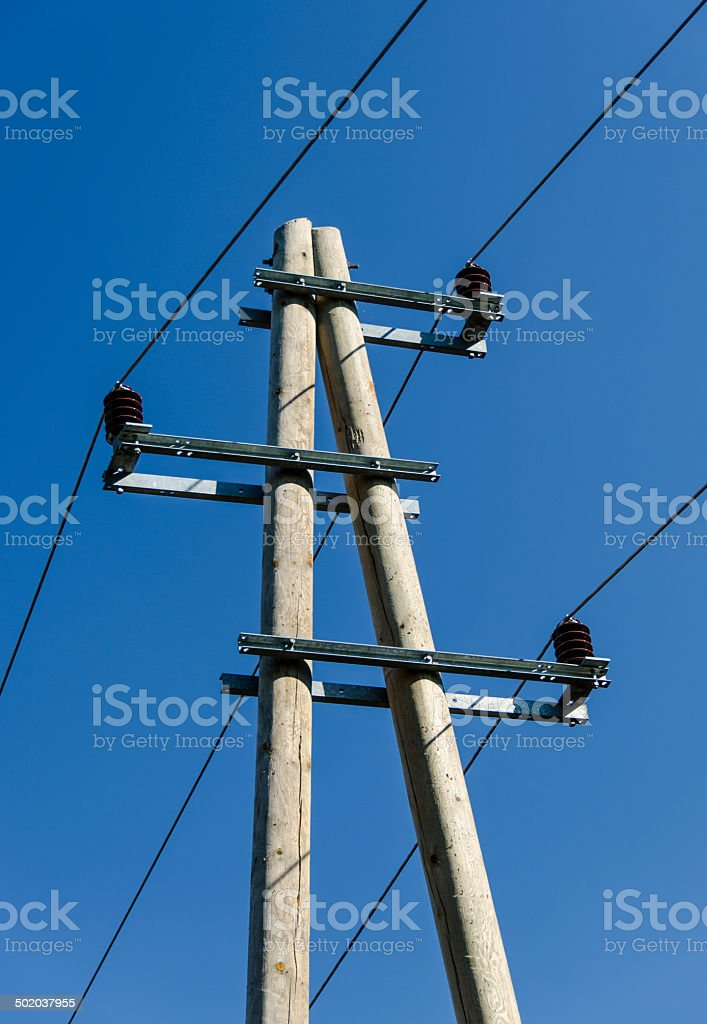 Wooden Pylon with Lines and Cables stock photo