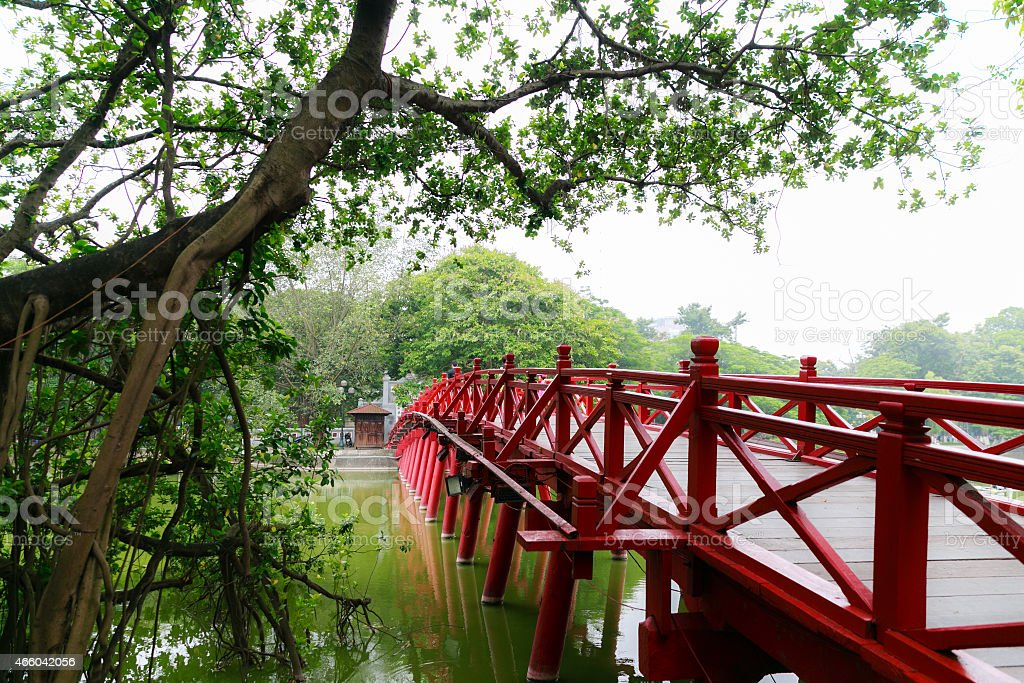 wooden railings of Huc Bridge in Hoan Kiem Lake stock photo