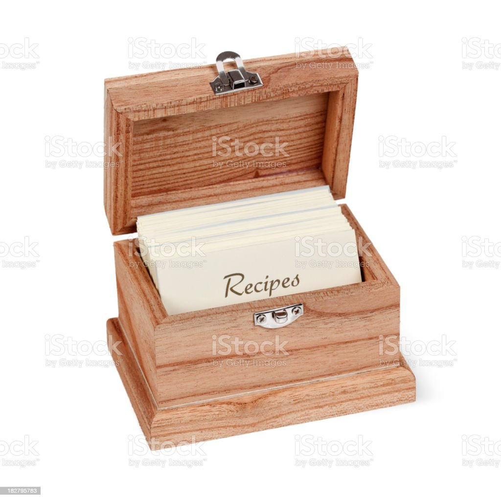 A wooden recipe box filled with recipe cards stock photo