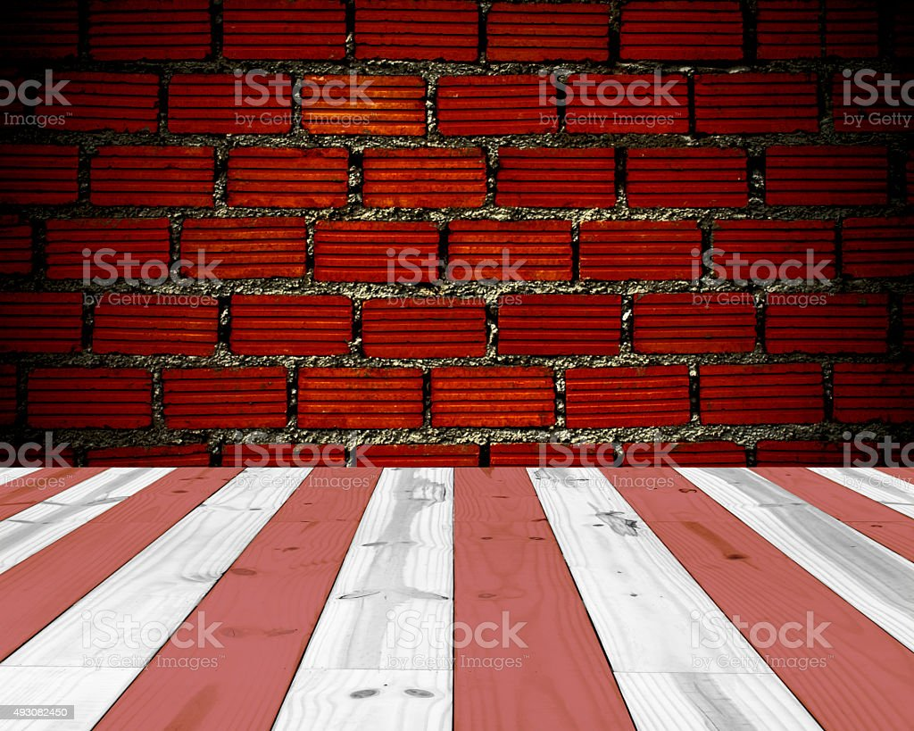 wooden red and white striped, and red brick wall royalty-free stock photo
