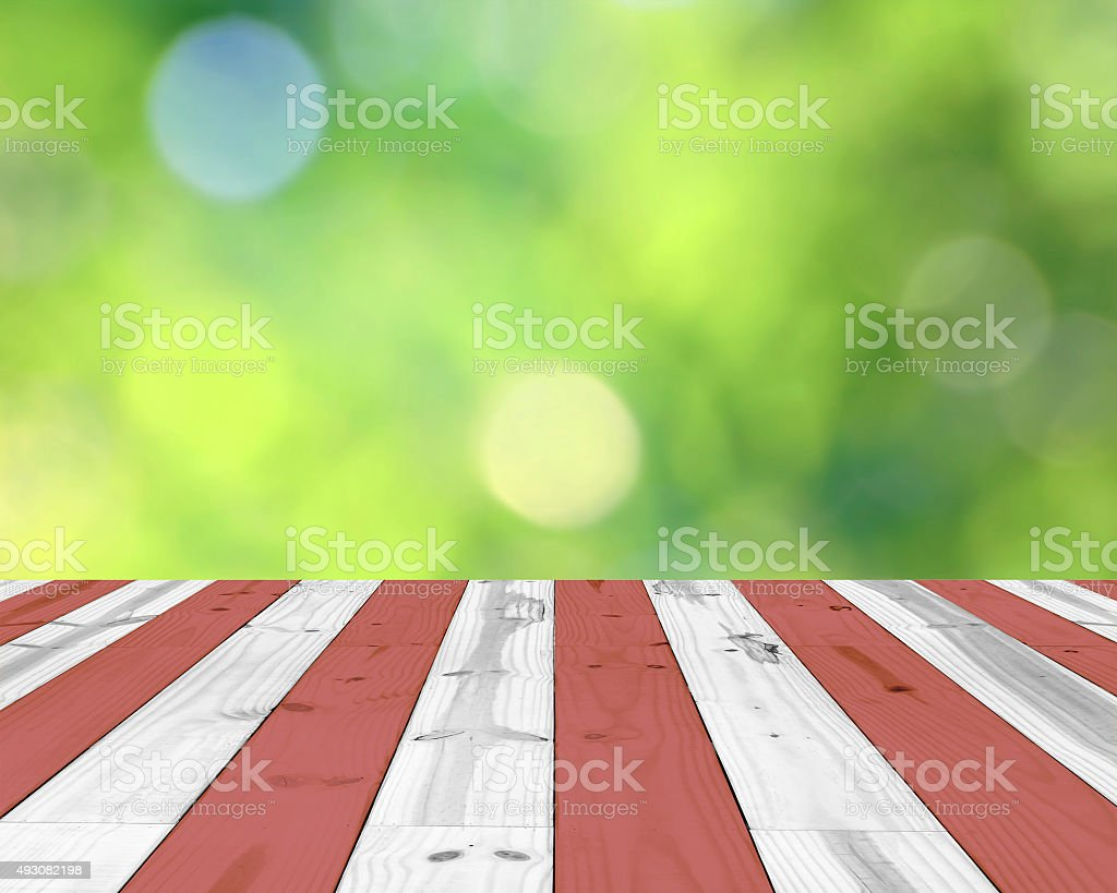 wooden red and white striped, top on green blurred background royalty-free stock photo