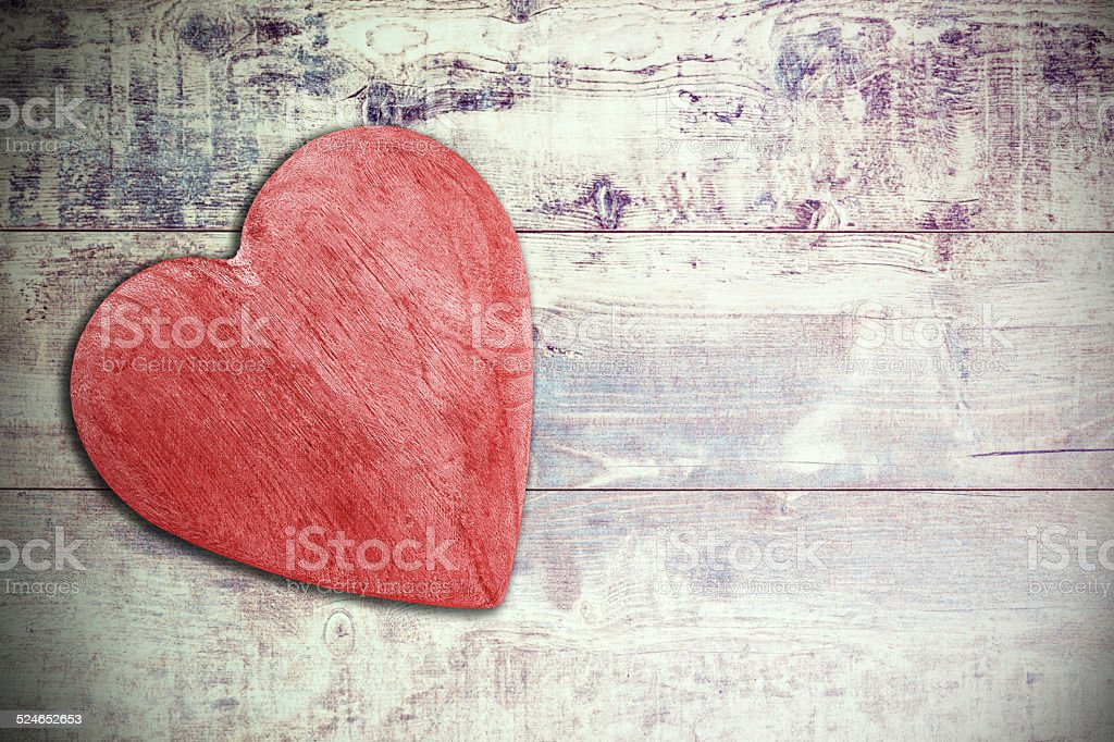 Wooden red heart on timbered background, space for text. stock photo