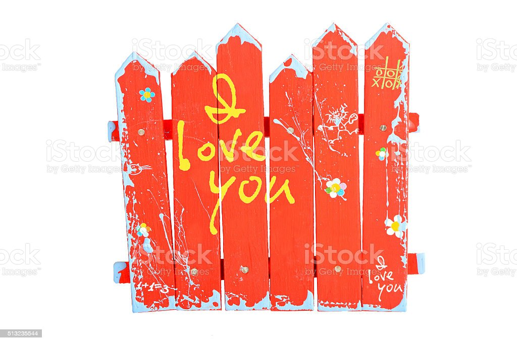 Wooden red souvenir handmade fence on white royalty-free stock photo