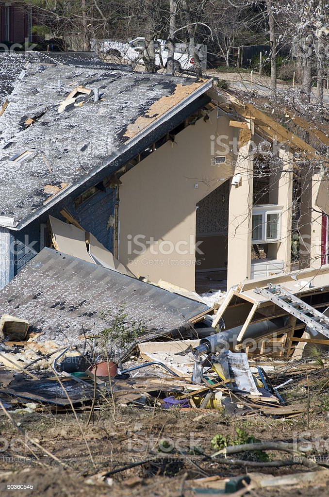 Wooden residential detached house with extensive damage after a tornado royalty-free stock photo