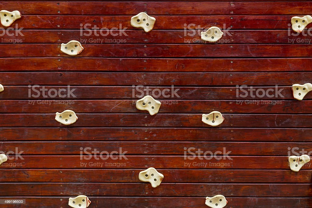 wooden rock climbing wall stock photo