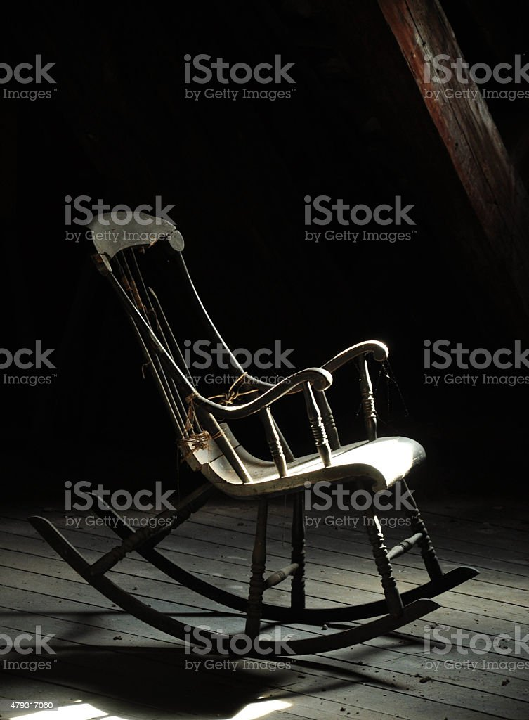 Wooden rocking chair stock photo