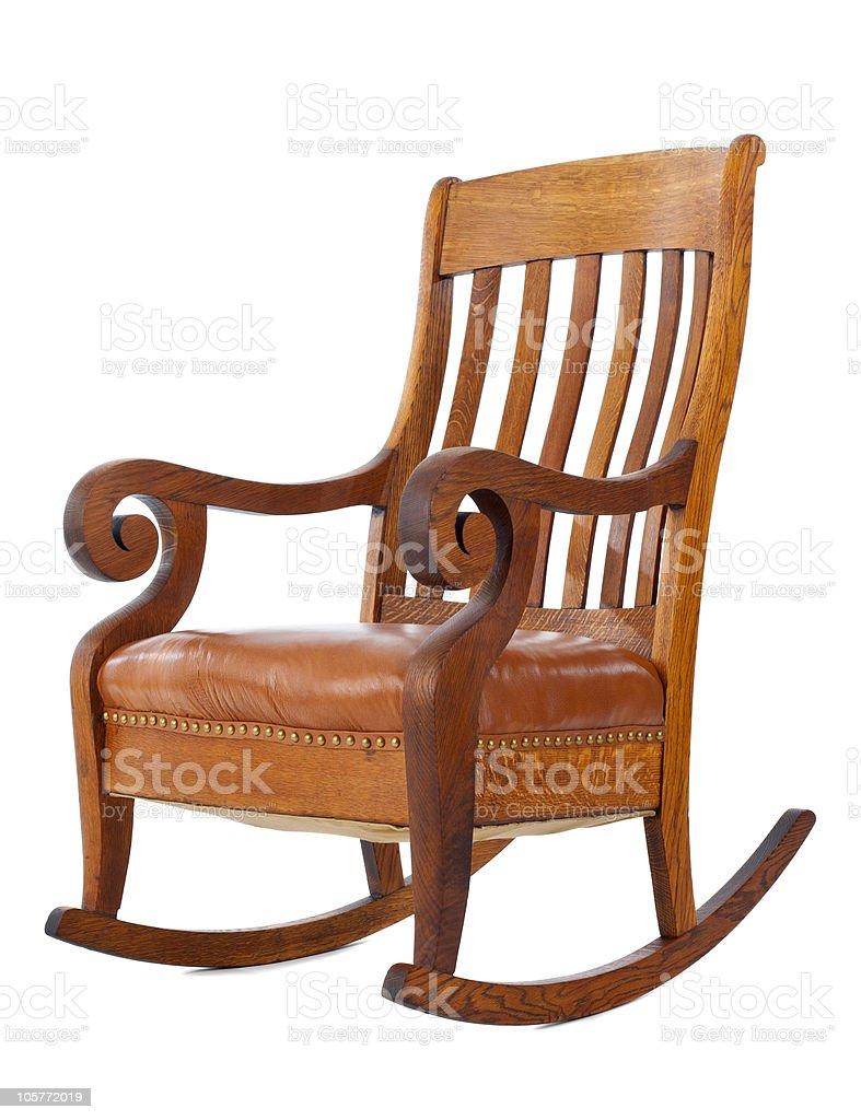 Wooden rocking chair standing against white background royalty-free stock photo