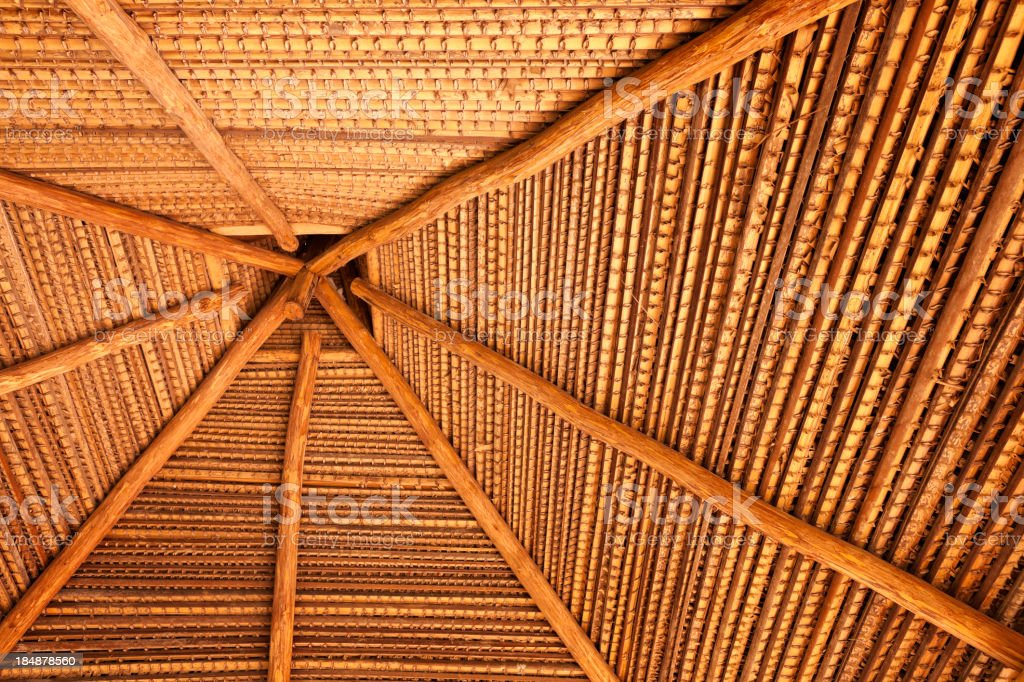 Wooden roof in a tropical native hut royalty-free stock photo