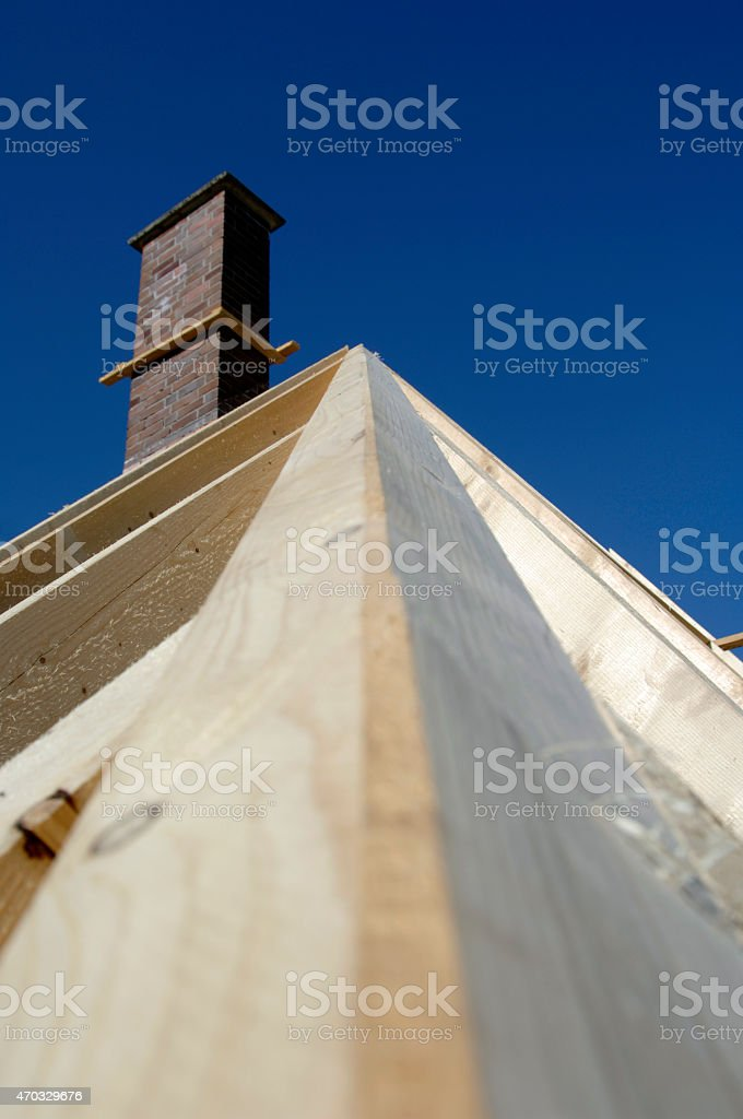 Wooden roof truss with chimney stock photo