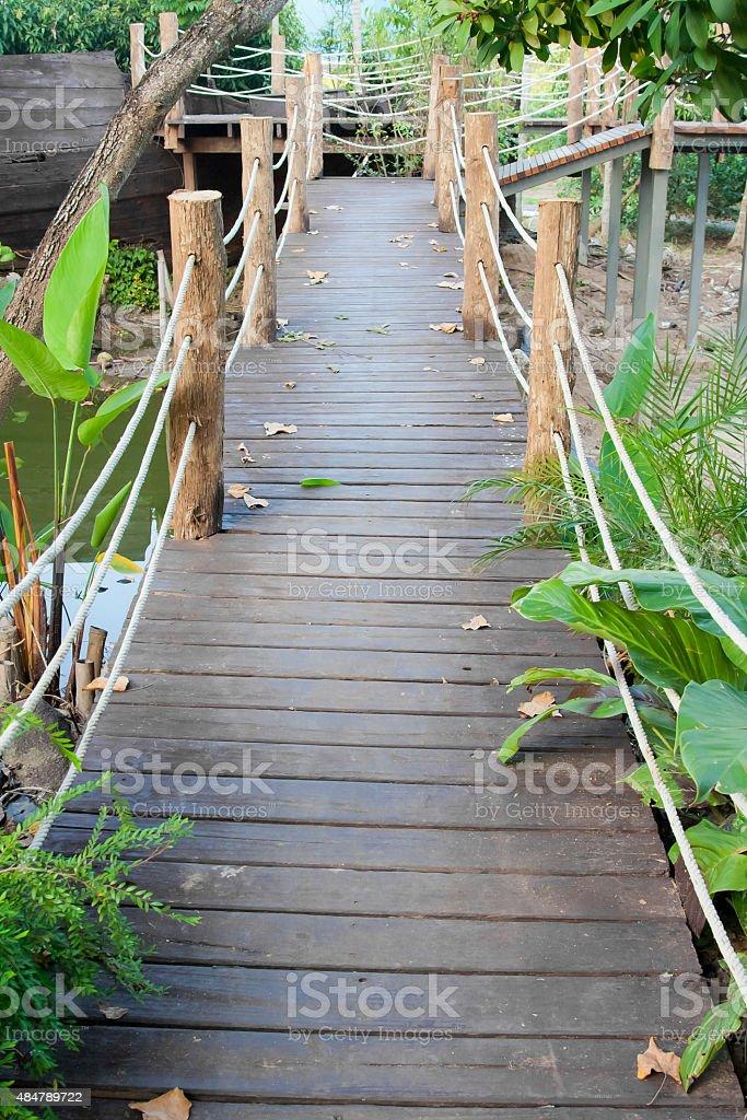 Wooden rope jungle bridge stock photo