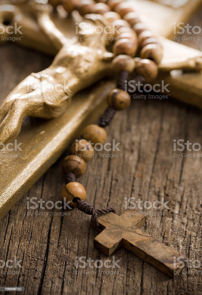 Wooden rosary beads and crucifix royalty-free stock photo