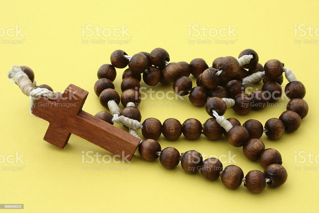wooden rosary on yellow royalty-free stock photo