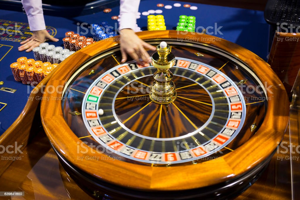 Wooden Roulette table in casino ball stock photo