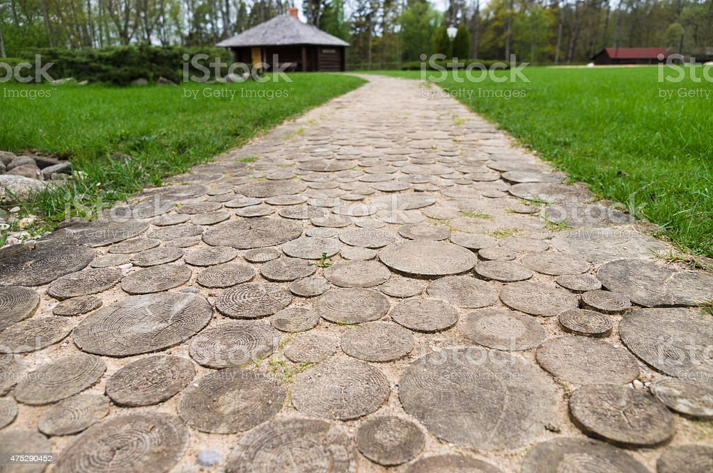 Wooden round log path closeup in summer recreation camping site stock photo