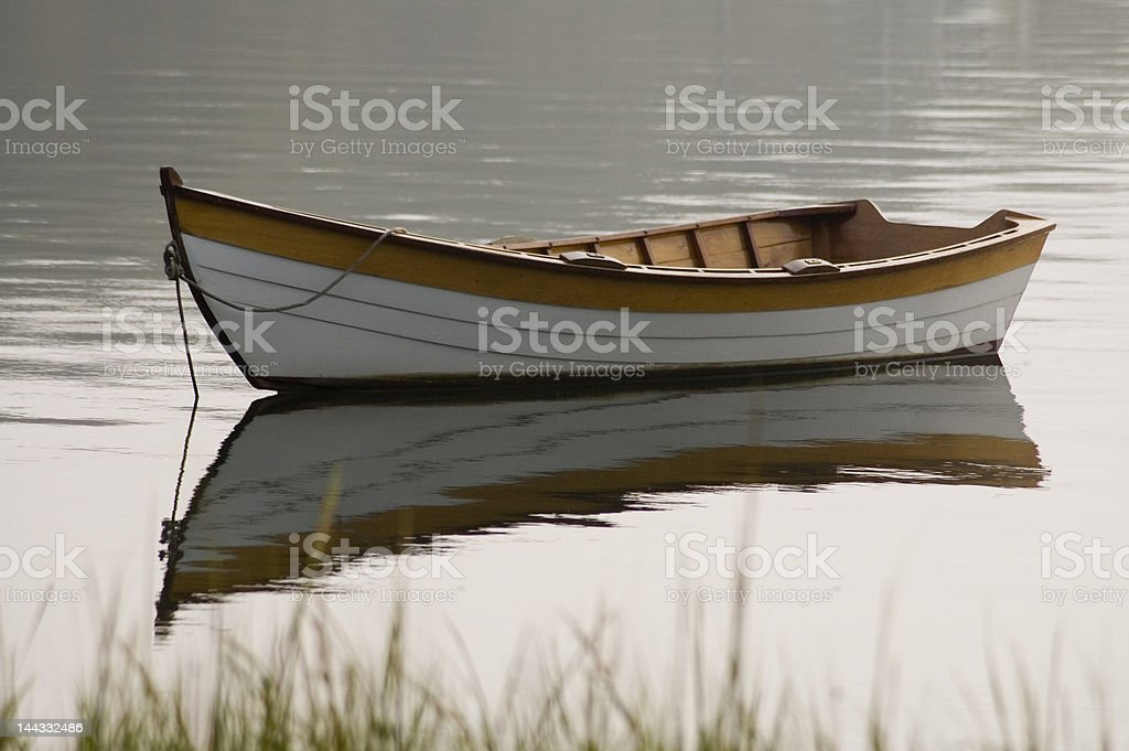 wooden rowboat anchored in harbor royalty-free stock photo