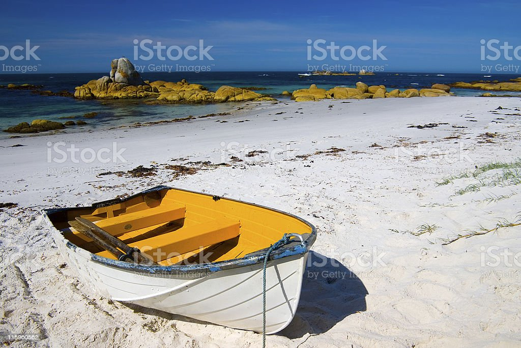 Wooden rowboat on beach white sand beach, Tasmania Australia royalty-free stock photo