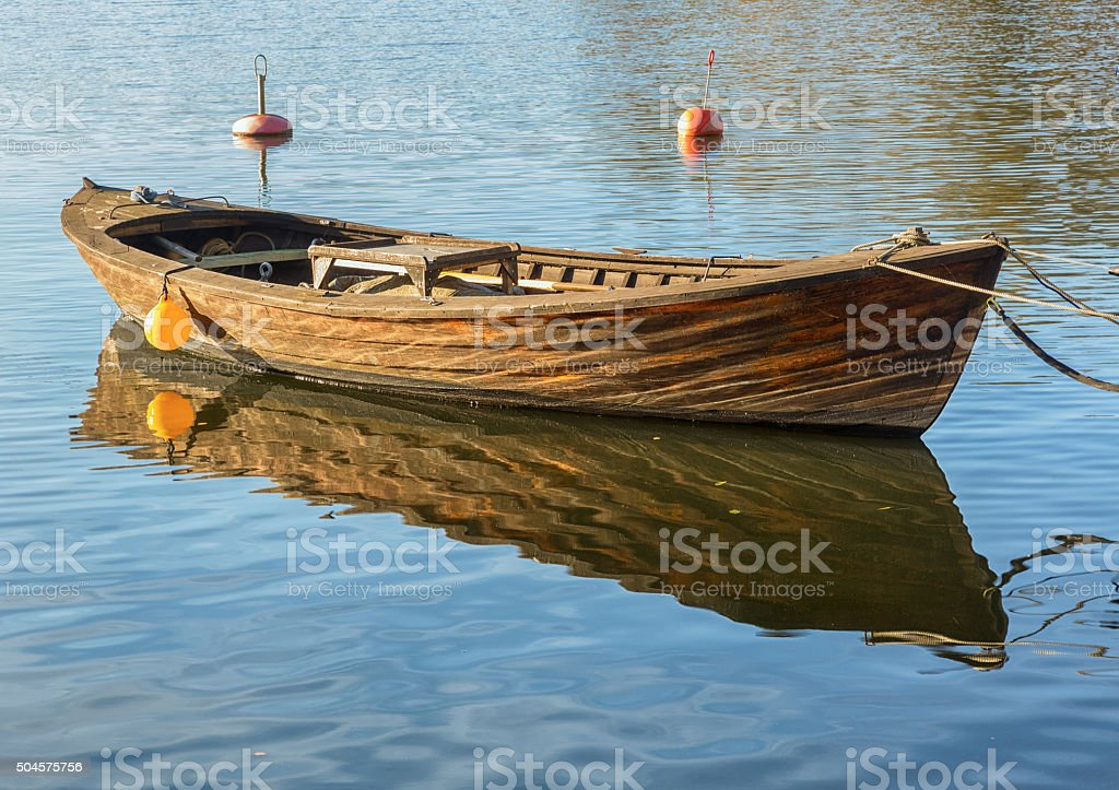 Wooden rowboat. stock photo