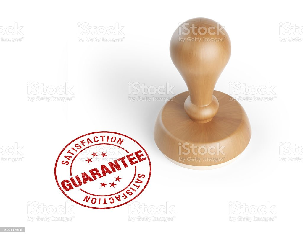 Wooden Rubber Stamp With Quarantee Stamp stock photo